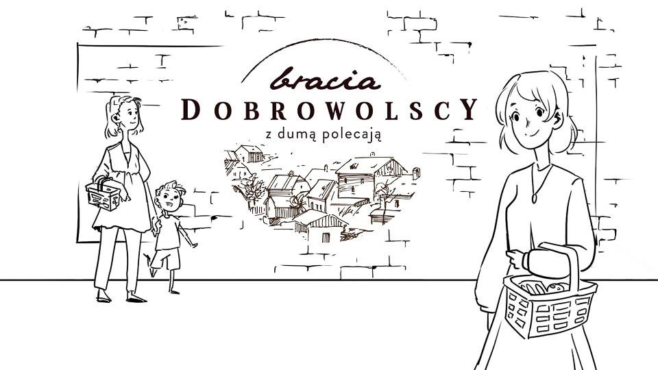 Mama zsynkiem idą nazakupy. Mijają mural zrysowaną grafiką zawierającą reklamę marki Dobrowolscy. Napierwszym planie inna klientka wracająca zesklepu zwypełnionym koszykiem.